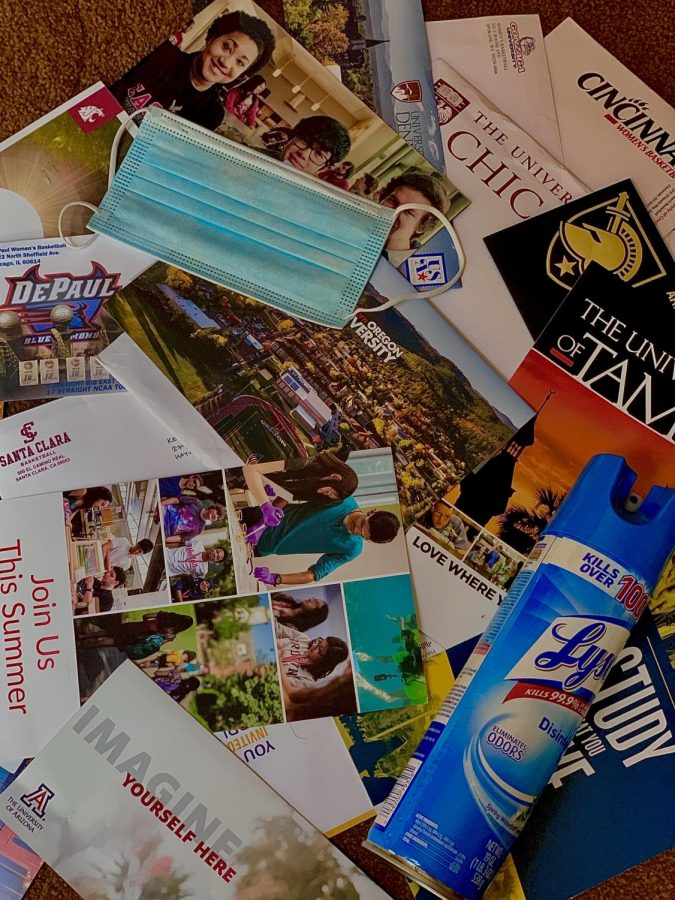 A mask and lysol sits along with many college flyers, one of the only ways students are able to get their college information in the face of the pandemic.